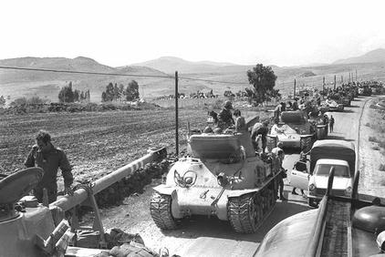 ISRAELI TANKS MOVING INTO POSITIONS FOR A COUNTER-ATTACK ON THE GOLAN HEIGHTS.