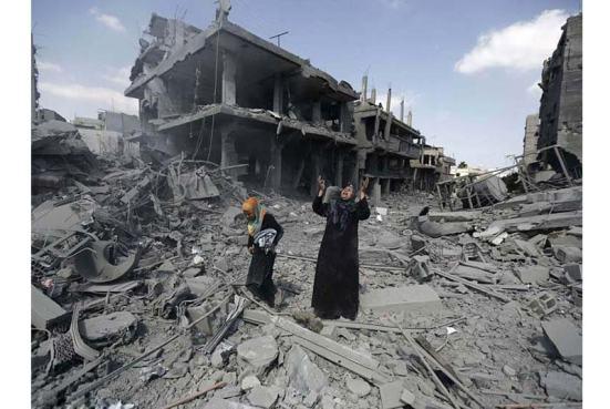 Người Palestine than khóc trước đống đổ nát sau những cuộc tấn công tên lửa của Israel