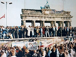 300px-West_and_East_Germans_at_the_Brandenburg_Gate_in_1989.jpg